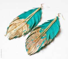 unique earrings unique leather feather earrings dipped in gold dollface magazine