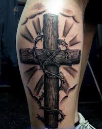 wooden cross with a thorny branch tattoo on half sleeve tattoos