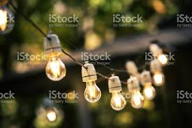 In Backyard Outdoor String Lights Hanging On A Line In Backyard Stock Photo