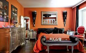 modern interior decorating with silver orange and dark room colors