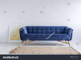 Living Room With Blue Sofa by Simple White Room Blue Sofa Rug Stock Photo 578977588 Shutterstock