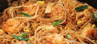 cuisiner des pates chinoises poêlée de nouilles chinoises et crevettes curry et coco recettes