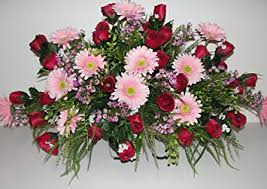 cemetery flower arrangements cemetery grave tombstone saddle headstone silk flower
