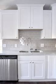 white kitchen cabinets with backsplash smoke glass subway tile white shaker cabinets shaker cabinets