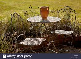 French Style Patio Furniture by French Style Metal Table And Chairs Furniture On Stone Patio In