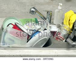 Kitchen Sink With A Pile Of Dirty Washing Up Plates And Dishes To - Dirty kitchen sink