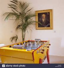 indoor palm table football indoor palm and artwork stock photo royalty free
