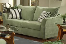 furniture green velvet deep sofa with oval wooden table using