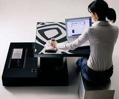 flat is a coffee table that lifts up and becomes a computer or