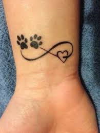 paw print tattoo with a heart tattoo pawprinttatto tats