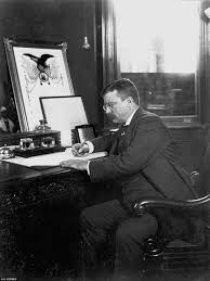 the president theodore roosevelt signs a