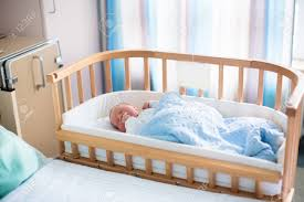 newborn baby in hospital room new born child in wooden co sleeper