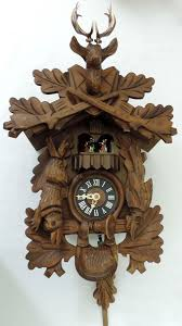 vintage traditional german black forest cuckoo clock music hunting