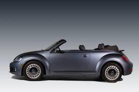 volkswagen bug light blue volkswagen launches new beetle models denim and rugged dune