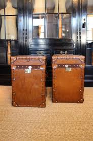 pair of bespoke antique leather trunks occasional tables