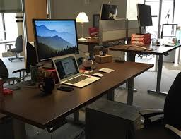 working desk adjustable height desks promote health and productivity alsco