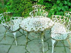 Antique Cast Iron Patio Furniture Wrought Iron Patio Furniture With Glass Top Great For Keeping The