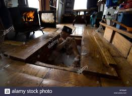 Heated Floor Under Laminate Man Bathing In His Hand Made Wood Cabin Where Bath Is Set Under