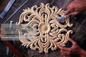 wood sculpture singapore up of wood carving brunei darussalam stock photo