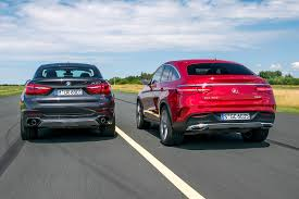 slammed smart car first comparison mercedes gle coupe vs bmw x6 by auto bild