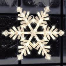 illuminated snowflake window silhouette lighted window christmas