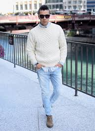 what to wear with light brown boots men s beige cable sweater light blue denim shirt light blue jeans