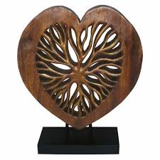 large wooden ornament on a stand with vein design