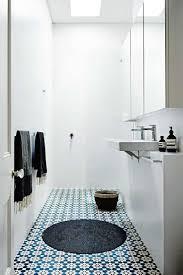 bathroom brick wall shower curtain white tile flooring mirror