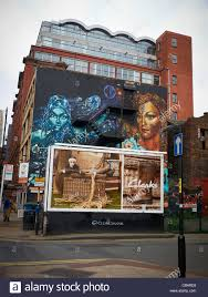 wall mural with clarks billboard ad in northern quarter manchester stock photo wall mural with clarks billboard ad in northern quarter manchester uk