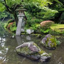 a fragment of japanese garden big rocks and stone lantern