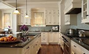 kitchen cabinet colors for black countertops ivory kitchen cabinets with black countertops transitional