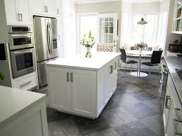 pale floor tiles with white kitchen colour schemes for