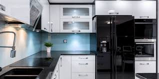 pictures of white kitchen cabinets with black stainless appliances black stainless steel appliances are the kitchen trend