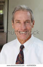 looking with grey hair handsome man grey hair looking camera stock photo 410592604