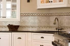 kitchen borders ideas travertine subway tile kitchen backsplash with a mosaic glass tile