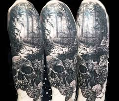 angry skull with forest tree design tattooshunter com