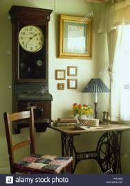 Corner Sewing Table by Antique Wall Clock Above Old