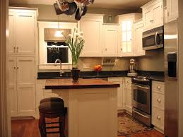l shaped white stained wooden kitchen cabinet using black marble