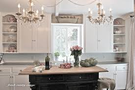 decor chandelier and white kitchen cabinets with kitchen island