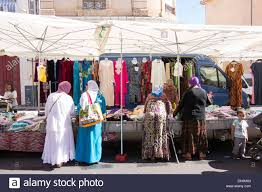 north african arab muslim french women in traditional dress shop
