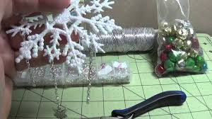 diy make gorgeous blinged out plastic snowflake ornaments