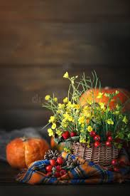 the table decorated with flowers and vegetables happy thanksgiving