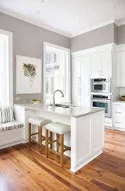 what color to paint a small kitchen with white cabinets sherwin williams paint color sherwin williams sw7023