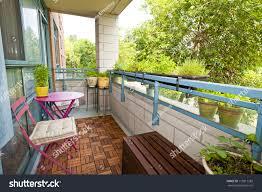 balcony condo patio furniture plants stock photo 113811283