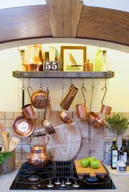 should i decorate on top of my kitchen cabinets decorating dilemma how to decorate above your stove nell