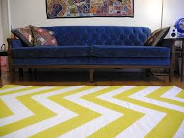 Navy Blue Tufted Sofa by Rugs Yellow Chevron Rug With Blue Tufted Sofa And Wall Art Plus