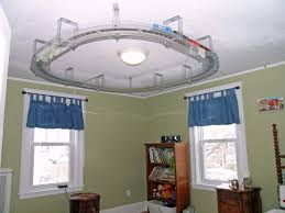 love the idea of a ceiling train track for my older son s bedroom love the idea of a ceiling train track for my older son s bedroom we were forever home pinterest train tracks ceilings and bedrooms