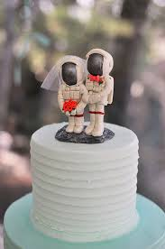 astronaut wedding cake toppers with moon base by cherryredtoppers