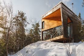 prefab cabin is all wood glass and mountain views curbed