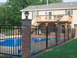 exterior great brick house houston with swimming pool and wooden